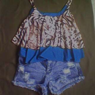 blue on its animal print loose crop top @ maong shorts.