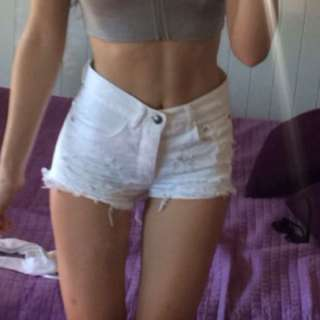 WHITE RIPPED HIGH WAISTED SHORTS
