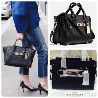 COACH Swagger Pebbled Leather