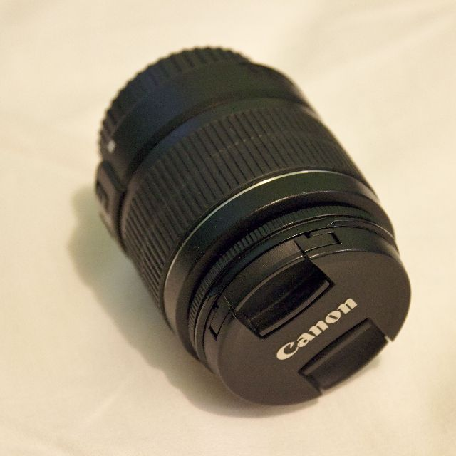 Canon 18-55mm kit lens, 2 caps included