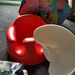 Bumbo seat with tray and seatbelt