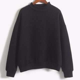 oversized sweater with mockneck collar in black