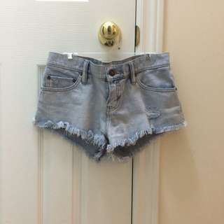 TNA denim cut-offs