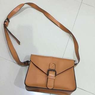 Brown sling bag