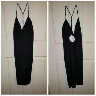 Black Midi Dress With Low Back And Crisscross Straps On Back.