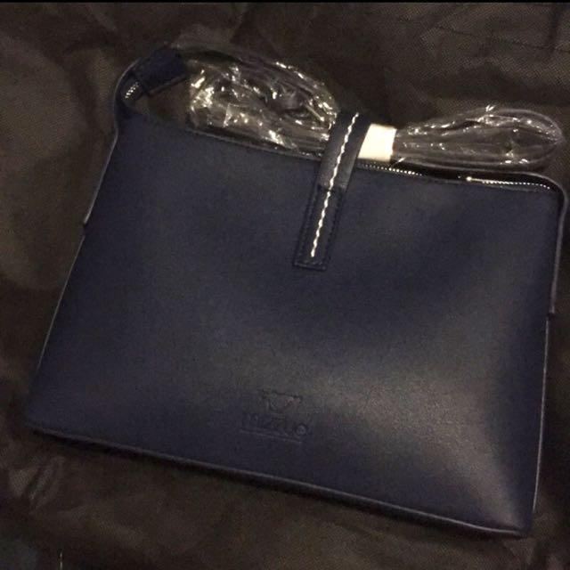 藍色進口皮簡約方型獨特皮繩扣小斜背包