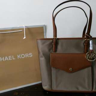 100%authentic  brand new Michael Kors tote. Firm price