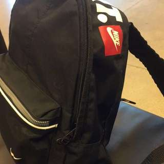 looking for small Nike black back pack