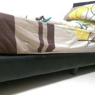 Solid bed frame for single mattress
