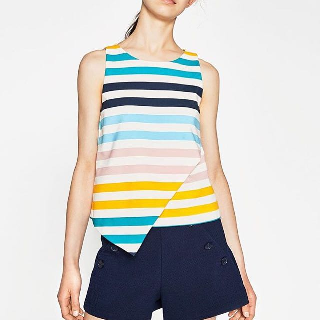 Multicolored asymmetrix top