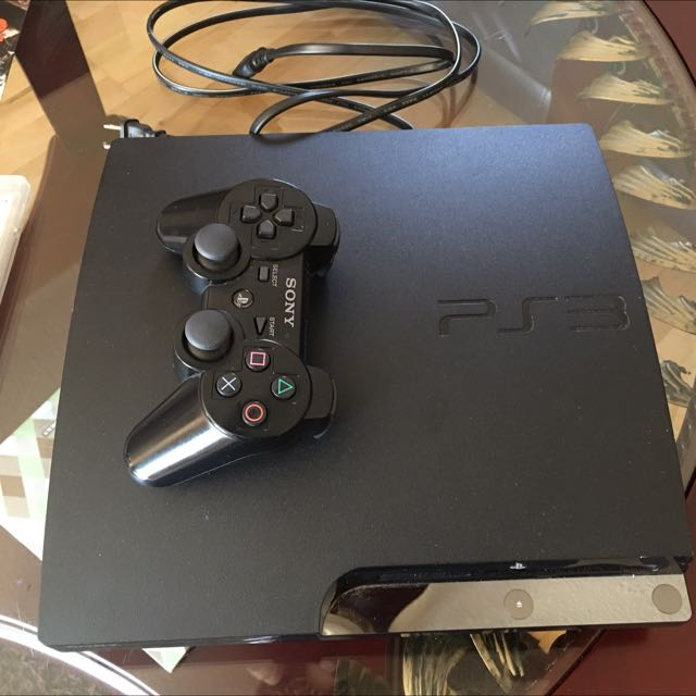 PS3 With Controller And 5 Games And Charger
