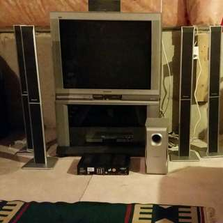 Panasonic Tau HD TV With Glass Door Cabinet, 5 Disk Dvd Player, Pvr Box, And 6 Surroundsound Speaker Set