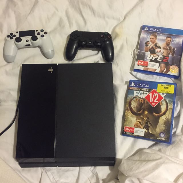 PS4 + 2 Controllers + 2 Games **PENDING**