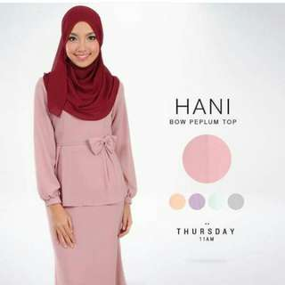 Hani Bow Peplum Top From Poplook