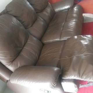 Three -Seat, Brown Leather Sofa With Adjustable Side Seats.