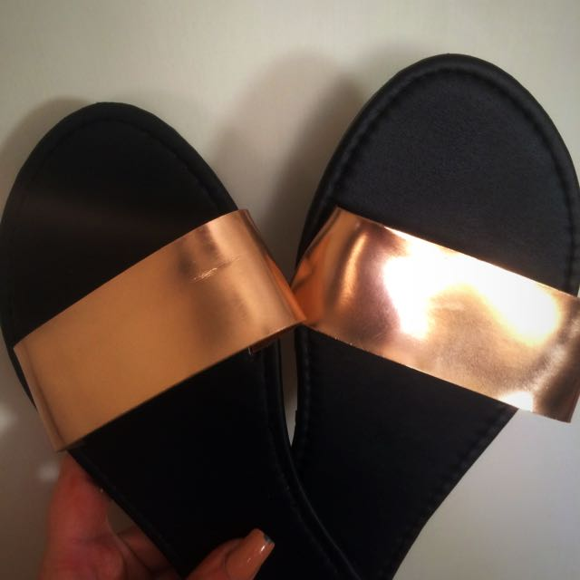 black/gold slip ons