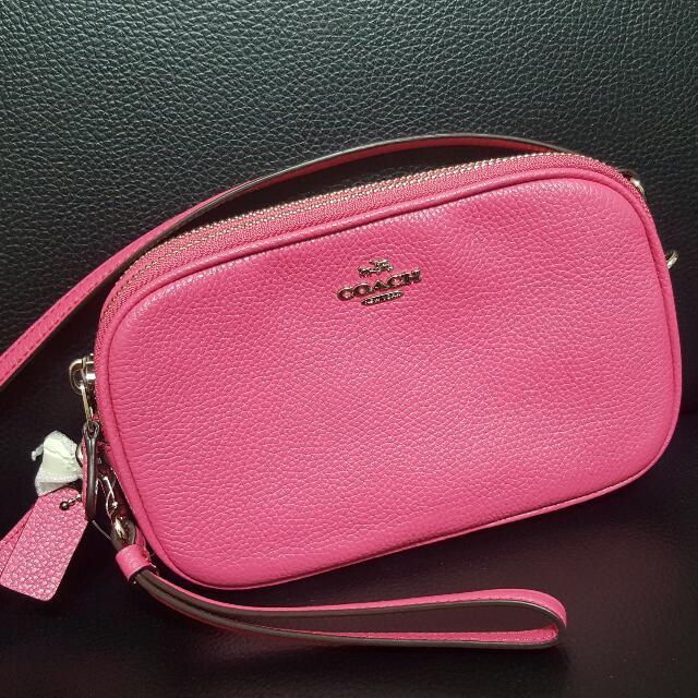 Coach 國外專櫃款。雙層斜背/手拿包。桃