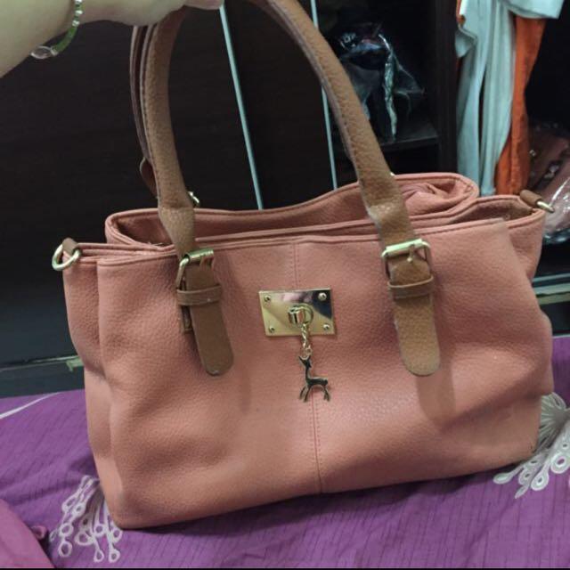 粉橘手提包
