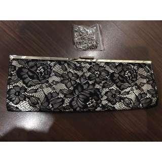 Una Rosa Black And Cream Clutch Bag With Strap