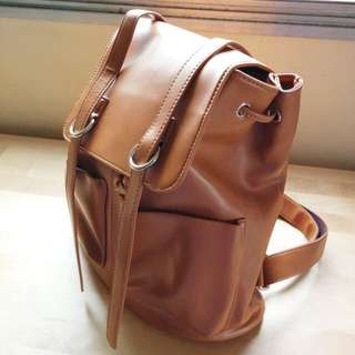 Brown synthetic leather backpack