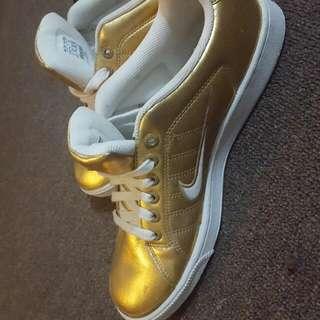 New Gold Nikes Women's Size 9
