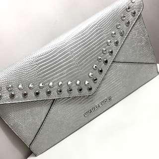Silver MK Clutch