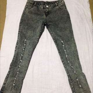 ripped ribbon jeans