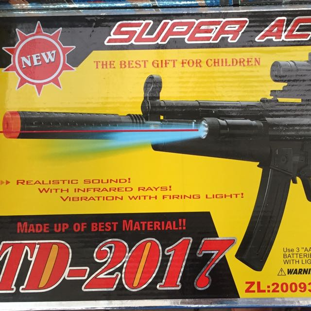 Get Quotations · Year of the multifunctional music and light submachine guns  electric light boy toy gun model gun