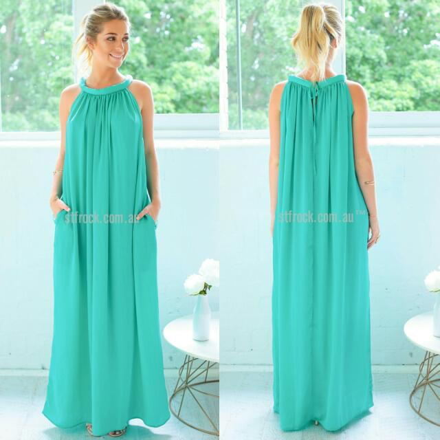 Green Maxi Dress With High Neck Twist Detail And Pockets