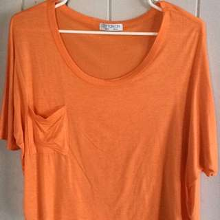 orange crop top with small pocket