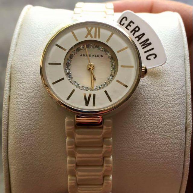 Anne Klein  11 Women's AK/2178IVIV Swarovski Crystal Accented Gold-Tone and Ivory Ceramic Bracelet Watch
