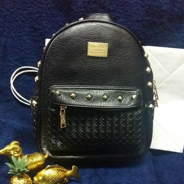 studded little black backpack