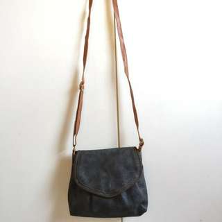 Leather sling bag with brown strap