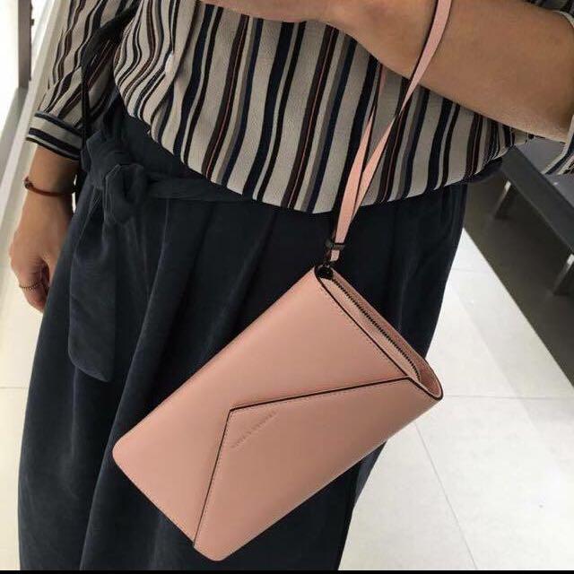 小CK粉紅色手拿包