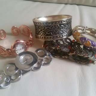 Mixture Of Bracelets And Watches