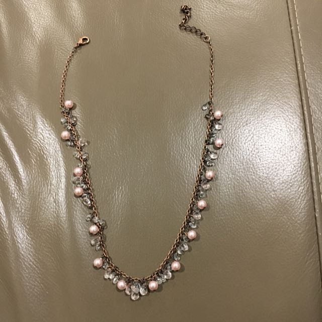 Pink and copper coloured beaded necklace
