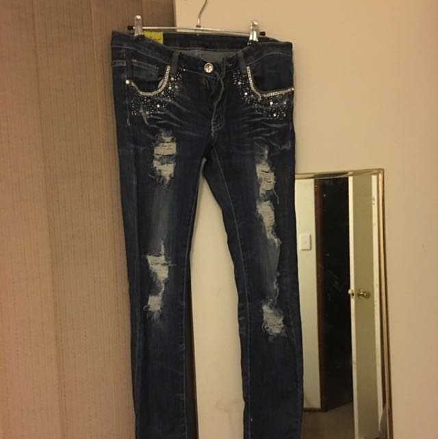 Ripped Low-rise Jeans