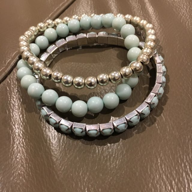 Turquoise/light blue and silver bracelets