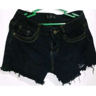 tattered and ripped shorts