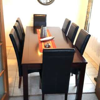 8 Seater Dark Wooden Dining Table..and 8 Dark Leather Chairs