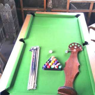 Pool Table ...set Of Cues ..Solid Wooden Cue Holder ...and A Full Set Of Balls...for the Avid pool Player