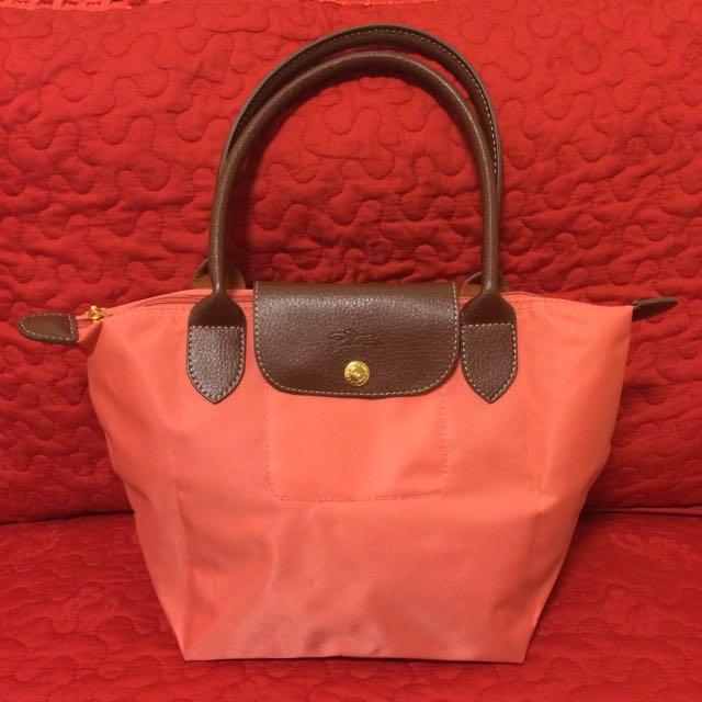 近全新_粉橘色防水尼龍材質折疊小手提包