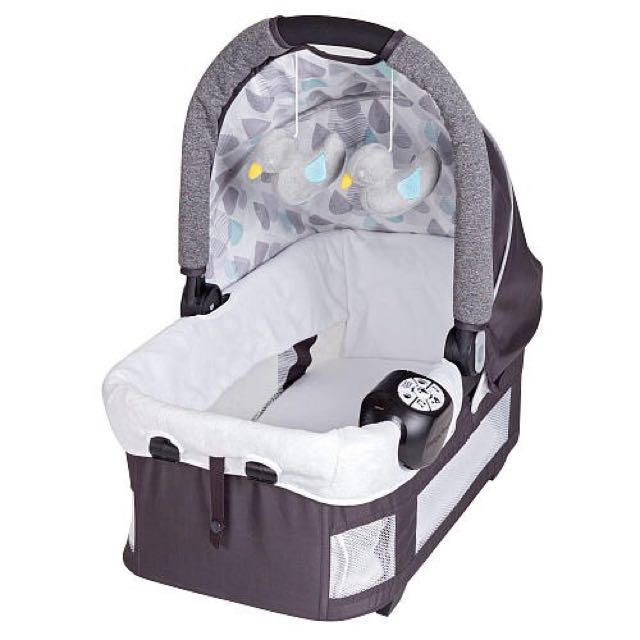Brand new Rock-A-Bye bassinet with 2 hanging toys