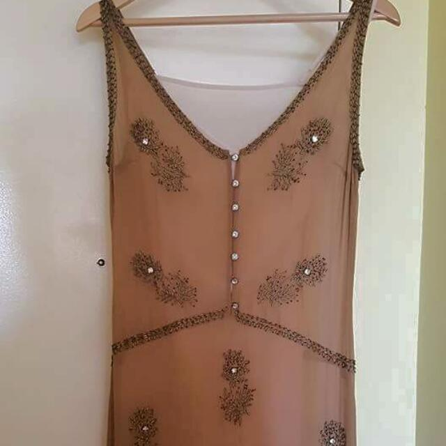 Near new Silk beaded sportgirl lined dress in size 8