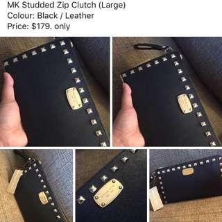 MK Studded zip Clutch