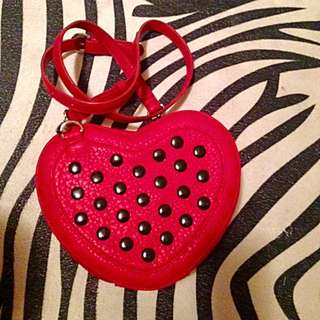 Heart shaped cross body purse.