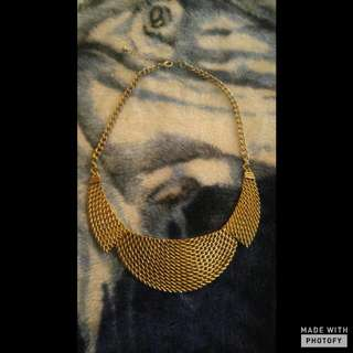 A Gold Bib Necklace Perfect For Any Fall Outfit