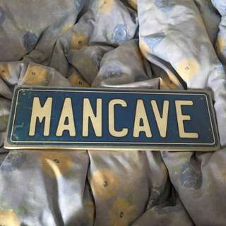 'man cave' wooden sign from 'typo'