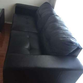 Two Black Leather Couches