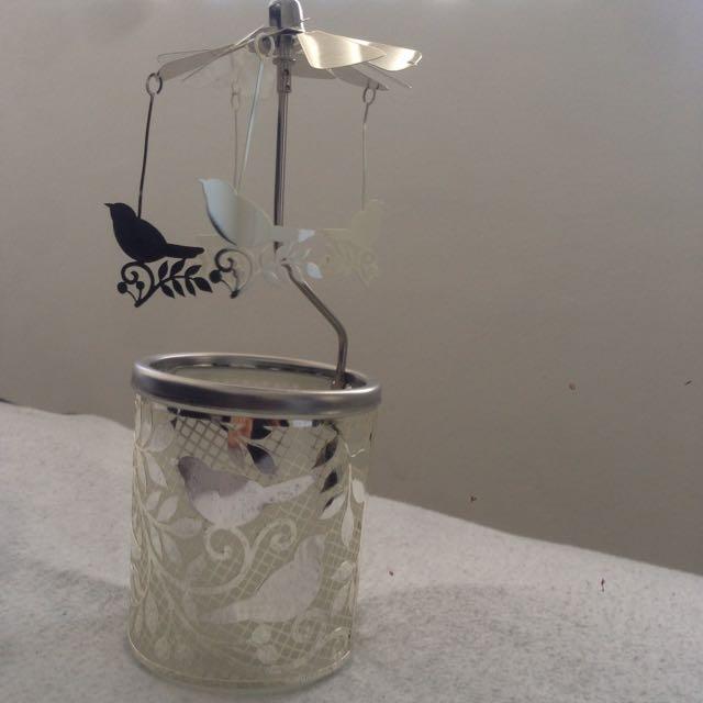 Dusk's bird Spinning Tealight Holder